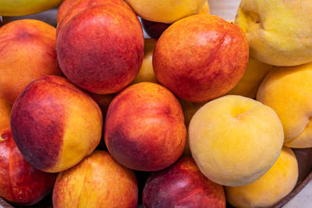Fresh ripe peaches on the counter of a farm shop