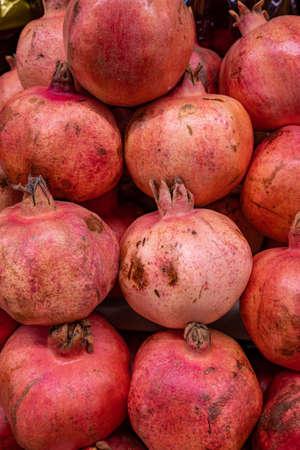 Fresh pomegranates, a tray of ripe juicy pomegranates close-up at the farmer's market Stok Fotoğraf