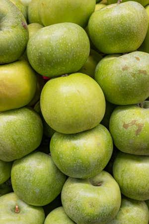 Fresh ripe green apples on the counter of a farm shop Stok Fotoğraf
