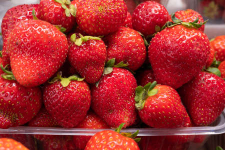 Fresh strawberries, a tray with ripe juicy strawberries close-up at the farmer's market Stok Fotoğraf