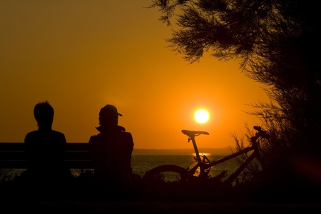 starigrad: Couple and a bicycle at sunset Stock Photo