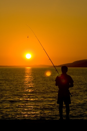 starigrad: Fisherman at sunset Stock Photo