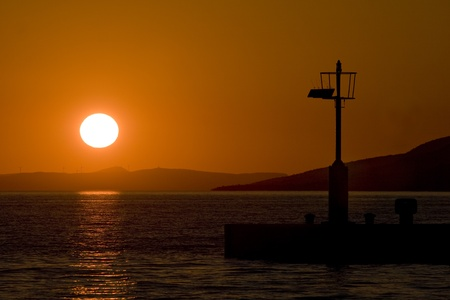 starigrad: Lighthouse at sunset