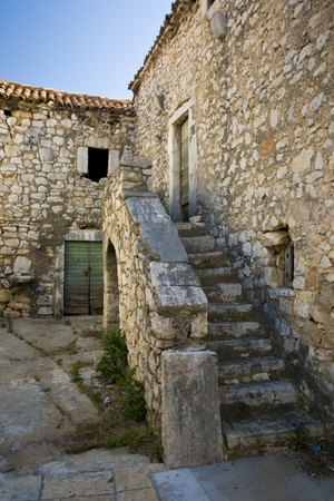 Old stony house with stairs