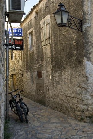 lamp made of stone: Narrow stone street in Pakostane in the afernoon