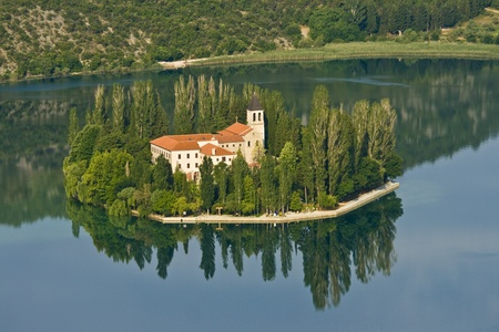 Visovac monastery, and the Visovac island part of the National park Krka, as settled and built in the 14th century. Today the rich monastery library includes particularly rare incunabula of Aesop`s fables from the 15th century.