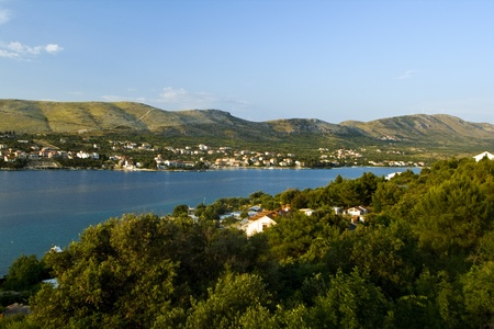 vegatation: Panorama of Grebastica with the blue water and the greenery