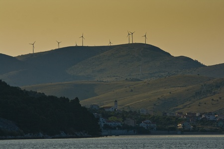 Panorama of Zaboric and wind turbines on the mountain photo