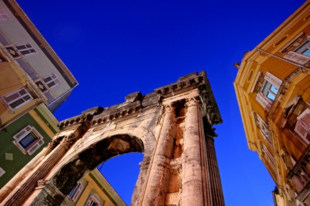 approximate: Arch of the Sergii is an Ancient Roman triumphal arch located in Pula, Croatia. approximate date of construction : 29-27 BC. The honorary triumphal arch, originally a city gate, was erected as a symbol of the victory at Actium. This arch has attracted the Stock Photo