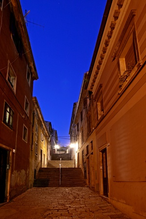 lamp made of stone: Old street in Pula with the stairs towards Kastel