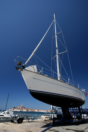 keel: Docked white yacht in the marina with the view to Rovinj