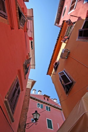 lamp made of stone: Picturesque part of old town core of Rovinj with colored old houses
