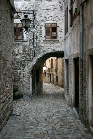 Stony street with the archway in old town Rovinj