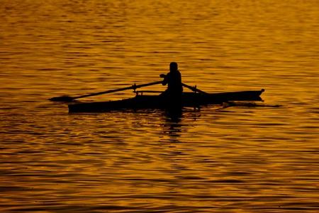 boatman: Boatman at golden sunset Stock Photo
