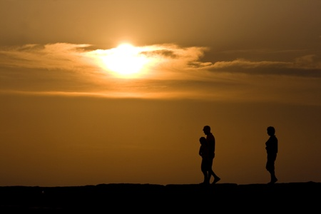 Family walking during the sunset in Fazana photo