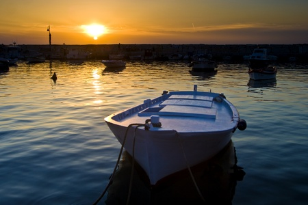 fishermens: Fishermen`s boat and the sunset in Fazana Stock Photo