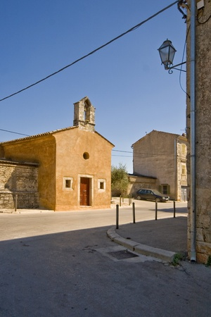 lamp made of stone: Street and the church in Galizana