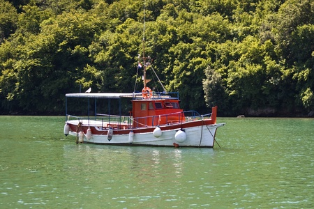 fishing cabin: Red wooden boat in Lim bay