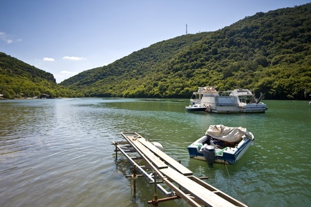 Old wooden dock in Lim bay photo