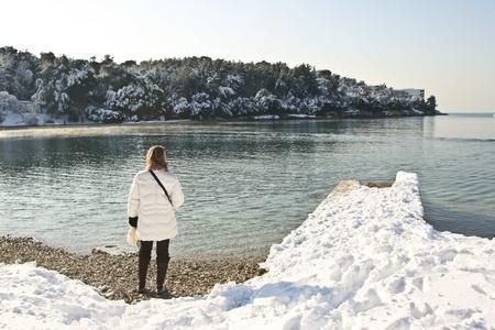 evaporating: Woman, snow, sea and pier