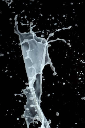 transcendent: Milky water forming waves Stock Photo