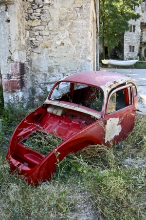 trashed: Deserted old red Beetle