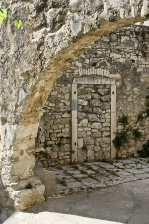 walled: Old stonemade walled door and medieval arc