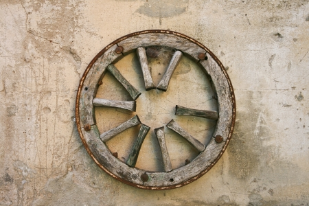 spoked: Old wagon wheel on the wall
