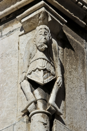 telamon: Old telamon figure on the Pula city hall Stock Photo