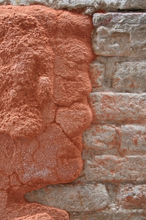anthropomorphism: Formed face on a wall
