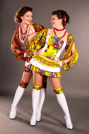 Ukrainian fashion girl, put his hands on hips, looking at each other, warm relationship, the singing blows