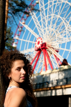 cotton candy: Girl on the background of these rides, Ferris wheel