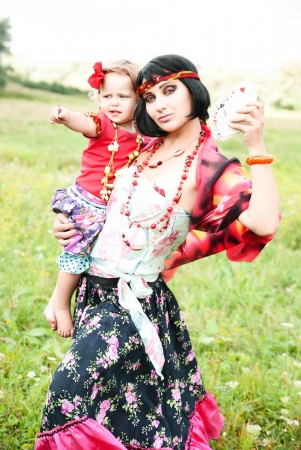 tell fortunes: Gypsy woman with her baby wants to tell fortunes by cards, and predict the future
