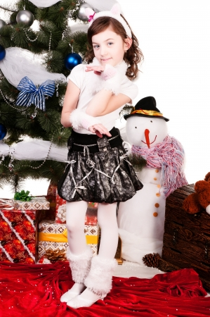 A girl stands near a Christmas tree, a beautiful girl in a cat costume photo