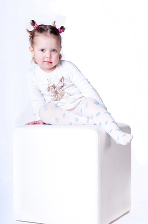 photography studio, a large cube, a girl in pajamas Stock Photo - 14282069