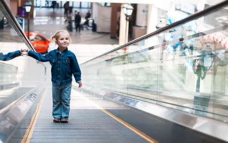 elevated walkway: little girl alone on the track to move people