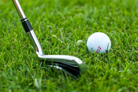 Illustration of a golf ball on a green meadow Stock Photo