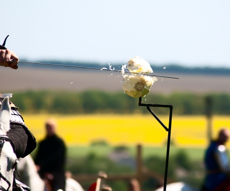 Knight cuts a head of cabbage in a big way, jousting competitions photo