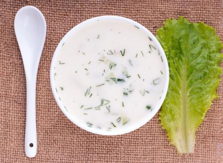 Close-up of russian cold vegetable soup on yoghurt (sour-milk) base - okroshka