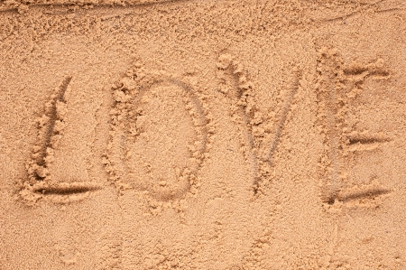 love message written in sand photo