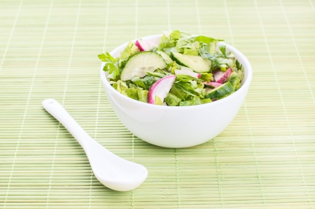Chopped salad with goat cheese on a green Stock Photo - 23975823