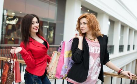 beautiful girls with shopping bags Stock Photo