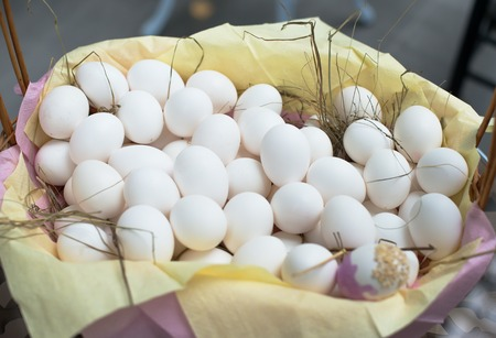 White eggs in basket, shopping for coloring eggs for Easter