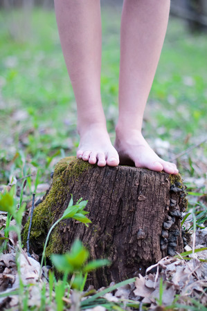 Close up of bare feet running on a trail in the forest. photo