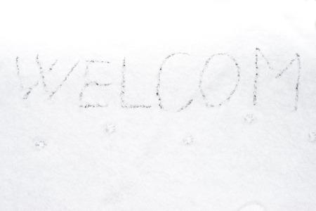 welcom: inscription welcom on snow-covered ice, the inscription on the snow