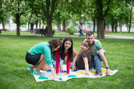 twister: Students play a game in the park twister, beautiful, indoor, little, happy, kindergarten