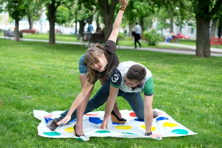 Students play a game in the park twister, beautiful, indoor, little, happy, kindergarten