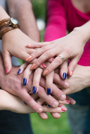 strength in unity: Closeup of pile of hands of a business team Stock Photo