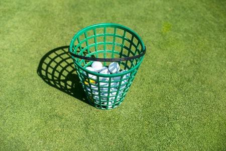 golf swings: A full bucket of golfballs on the driving range Stock Photo
