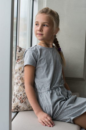 Young girl by the window, adult